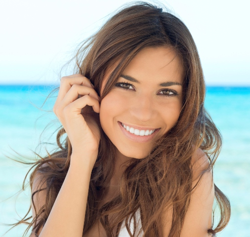 Young Woman Smiling At Beach